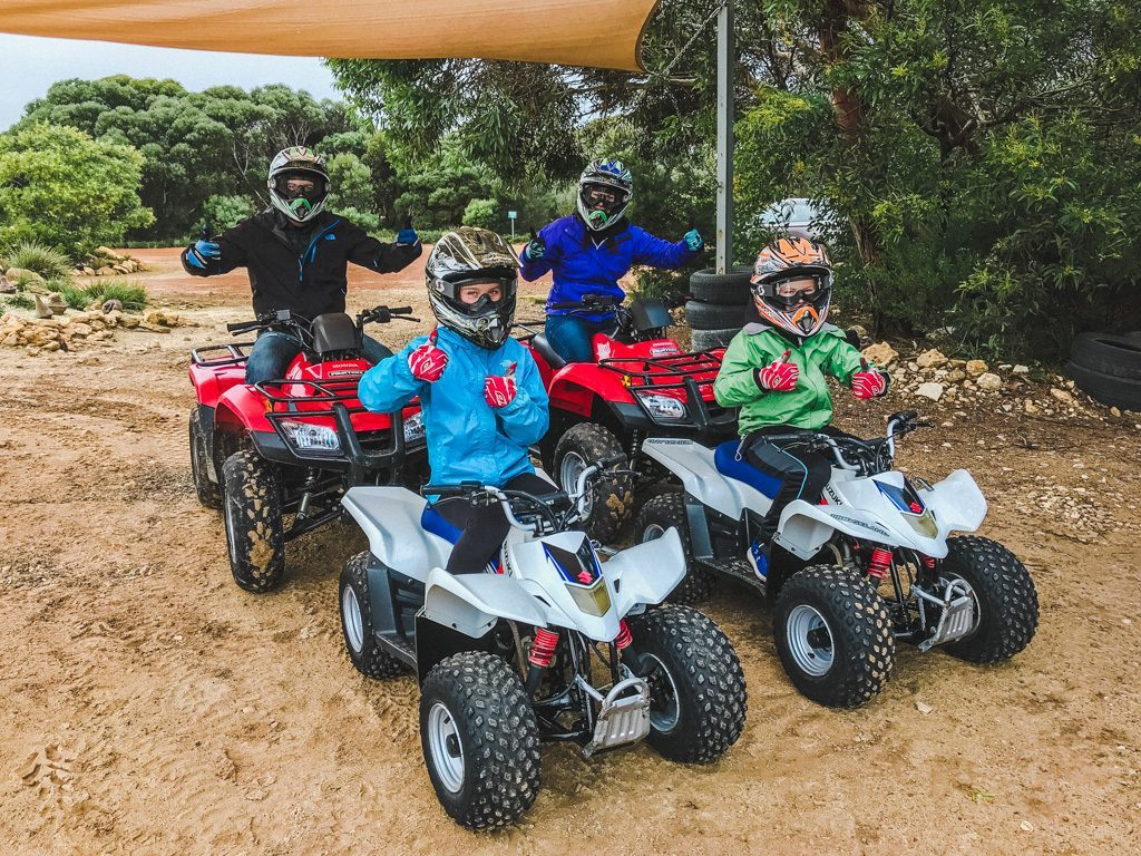 family riding quads on kangaroo island
