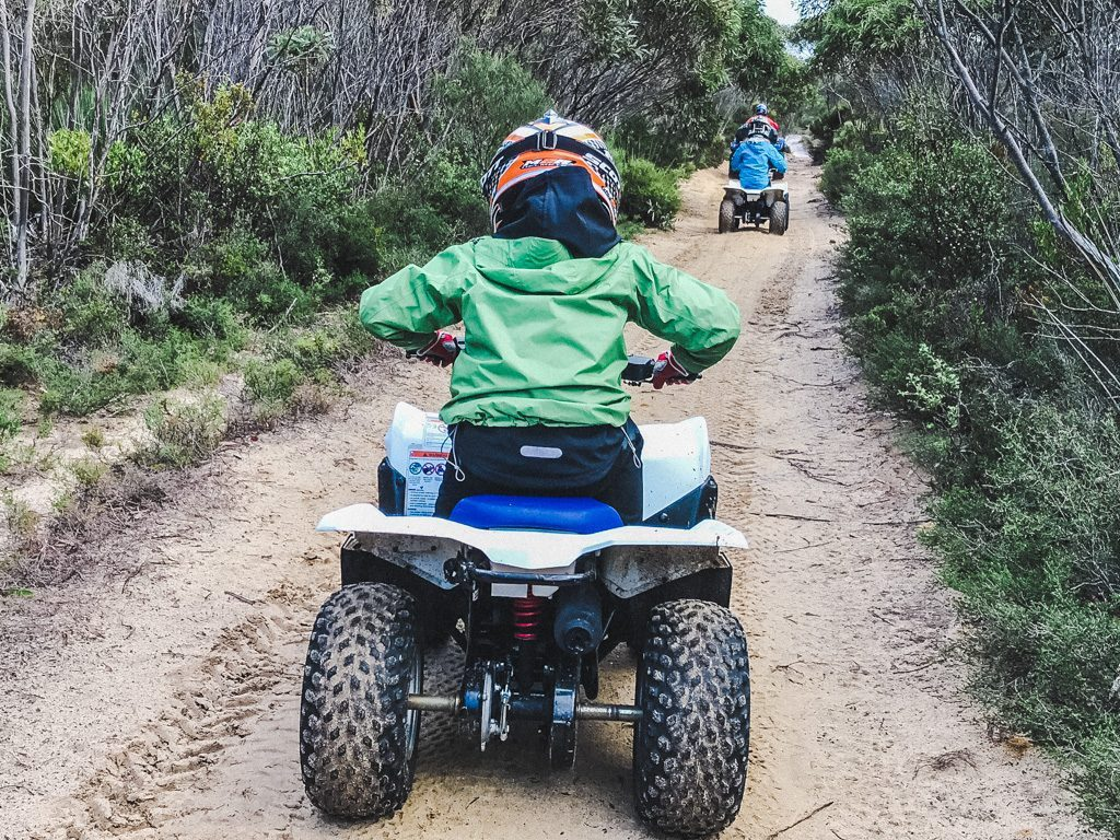 boy riding down dirt path on a quad with Kangaroo Island Outdoor Action