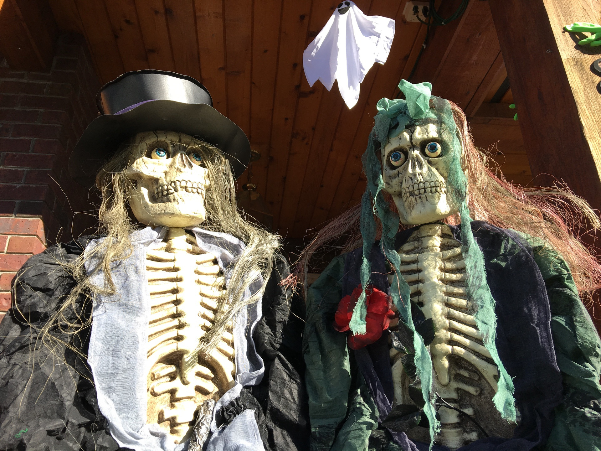 skeleton characters on front porch of haunted house langley