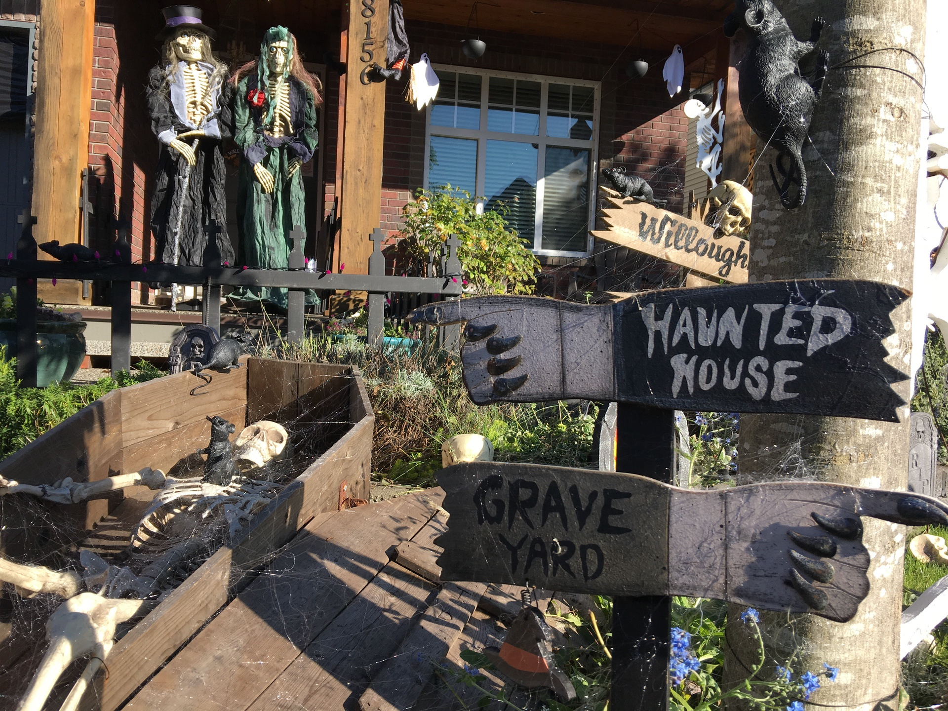 halloween decorations in the front yard of haunted house langley