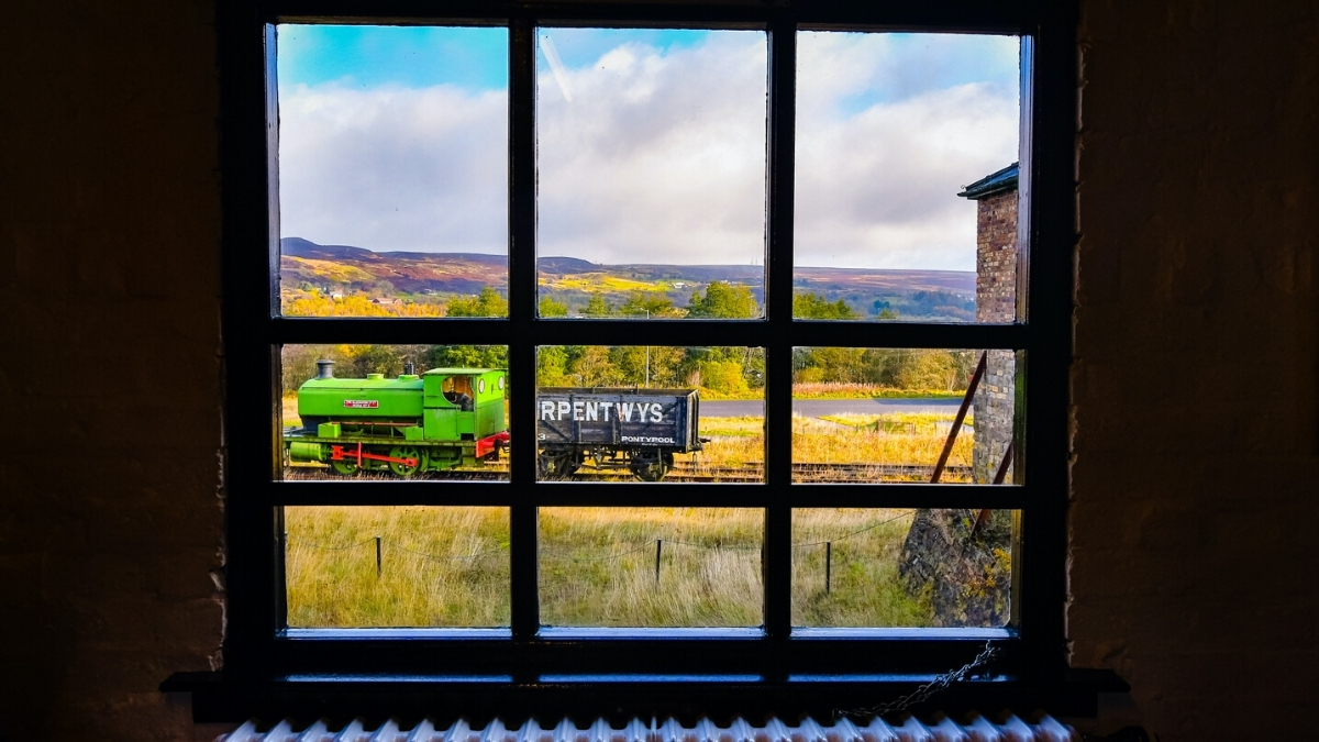 looking out a window at the big pit national coal museum at a train