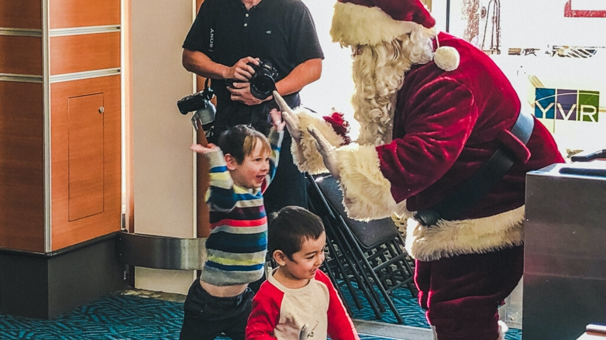 Santa giving a high-five to a child