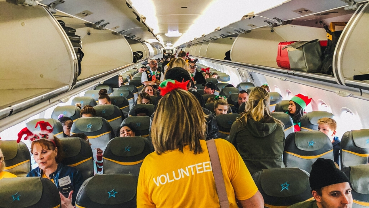 Photo of passengers on the plane for Children's Wish Flight in Search For Santa