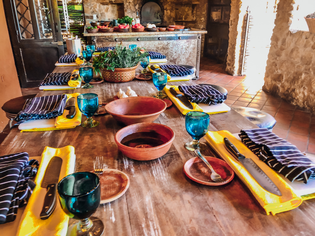 table laid out with chopping knifes and aprons all ready for Cooking Classes in San Jose Del Cabo