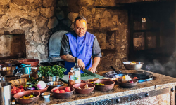 man in kitchen at cooking classes in san jose del cabo