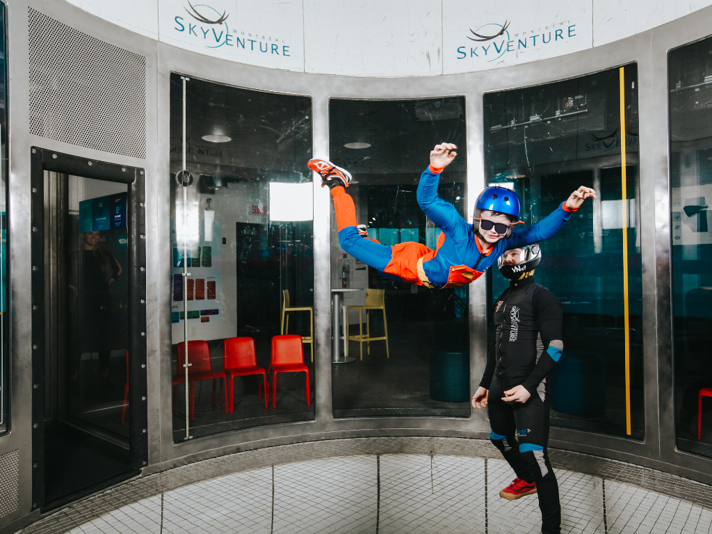 Young girl flying at indoor skydiving Montreal