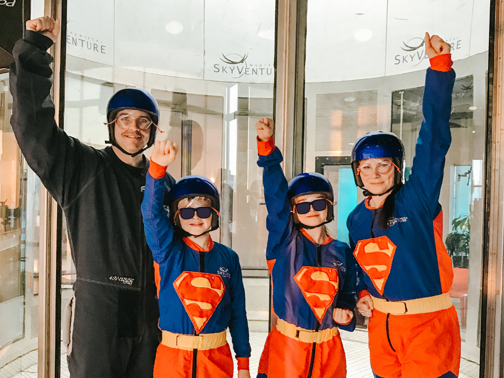 Jami Savage and family posing before indoor skydiving Montreal