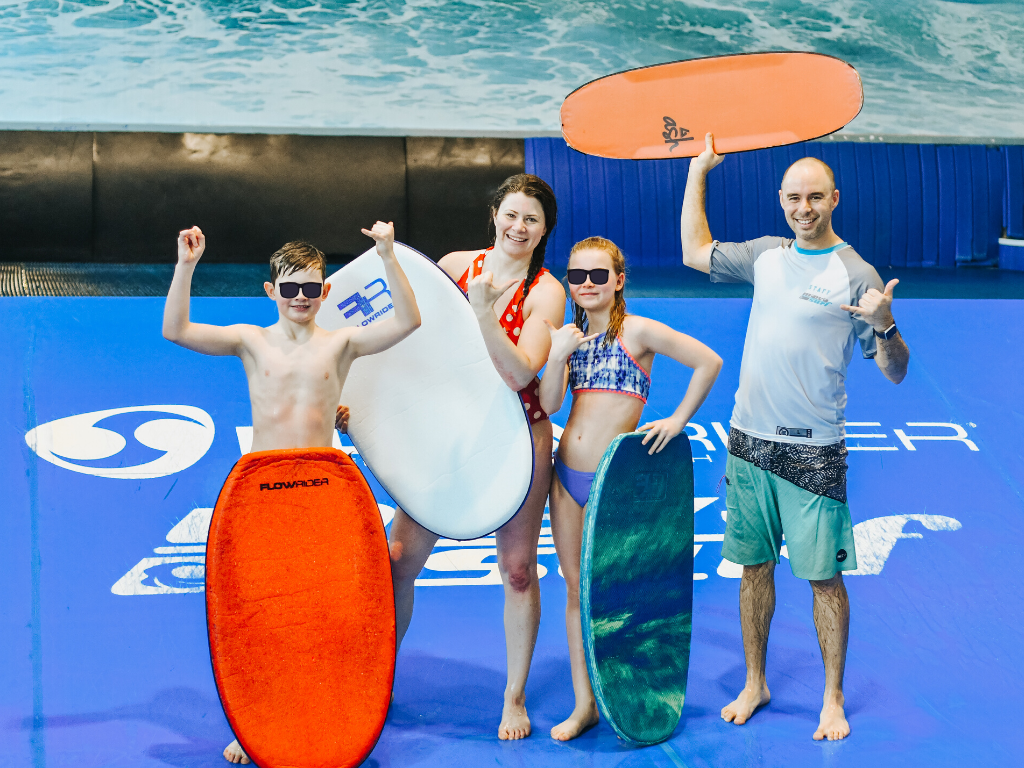 jami savage and family standing with instructor at laval indoor surfing