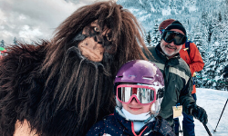Girl and Man posing with Sasquatch mascot