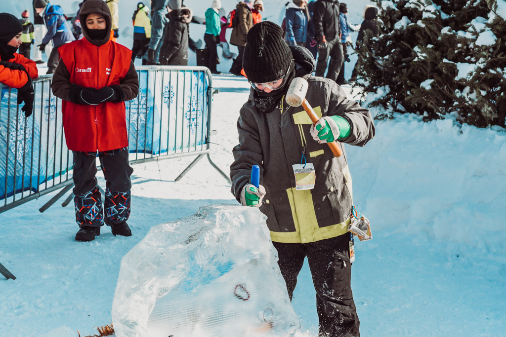 Child picking ice at Winterlude festival