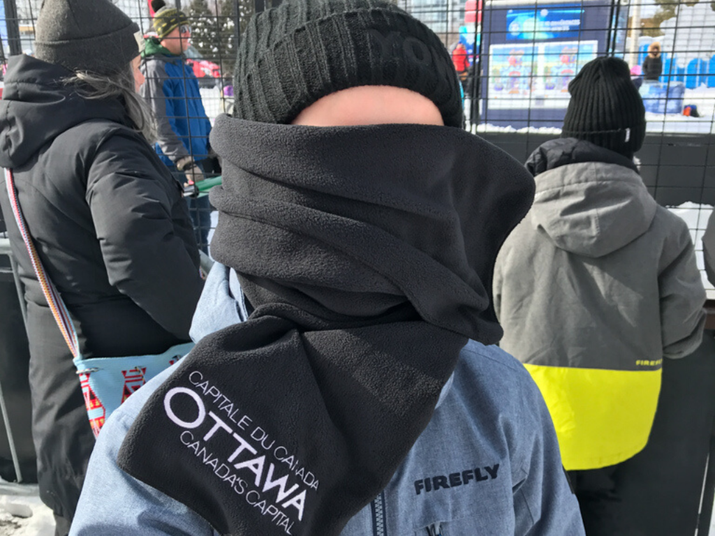 girl who is bundled up for the cold weather and has a scarf over her face at winterlude guide