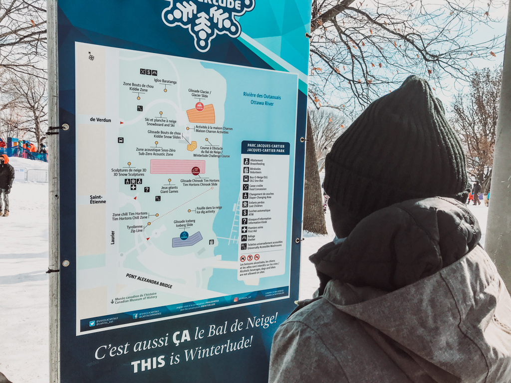 woman looking at activities available on the winterlude guide map