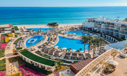 outside view of the pools and beach at le blanc spa resort los cabos reviews