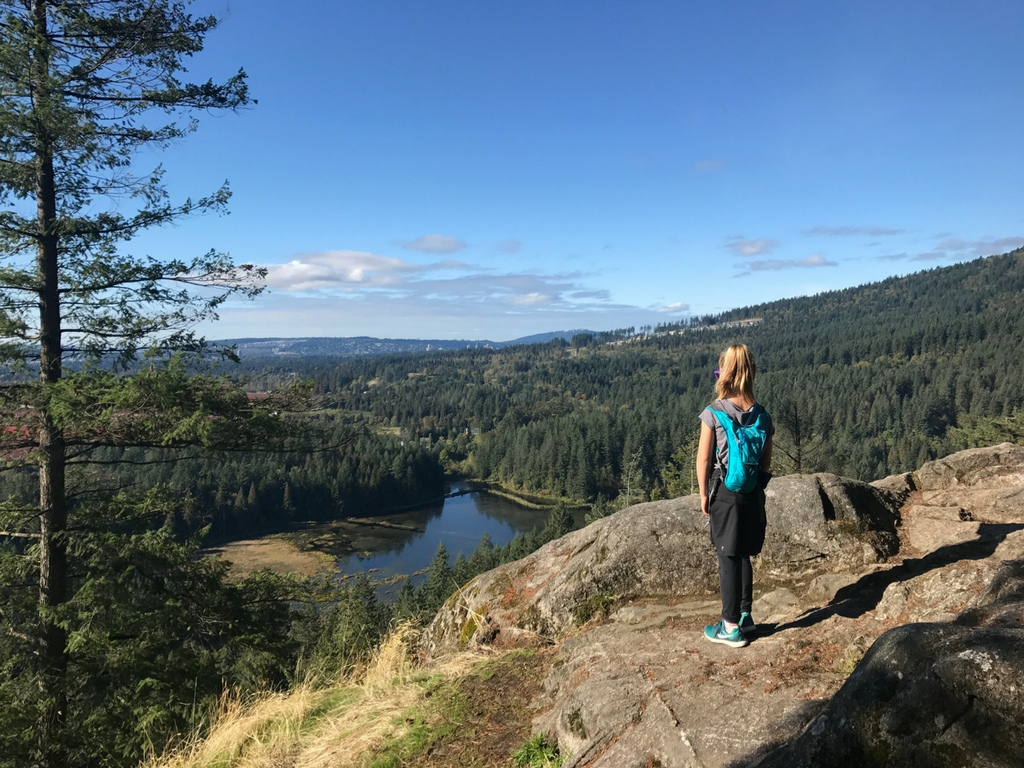 girl on the top of a mountain at the end of a hike