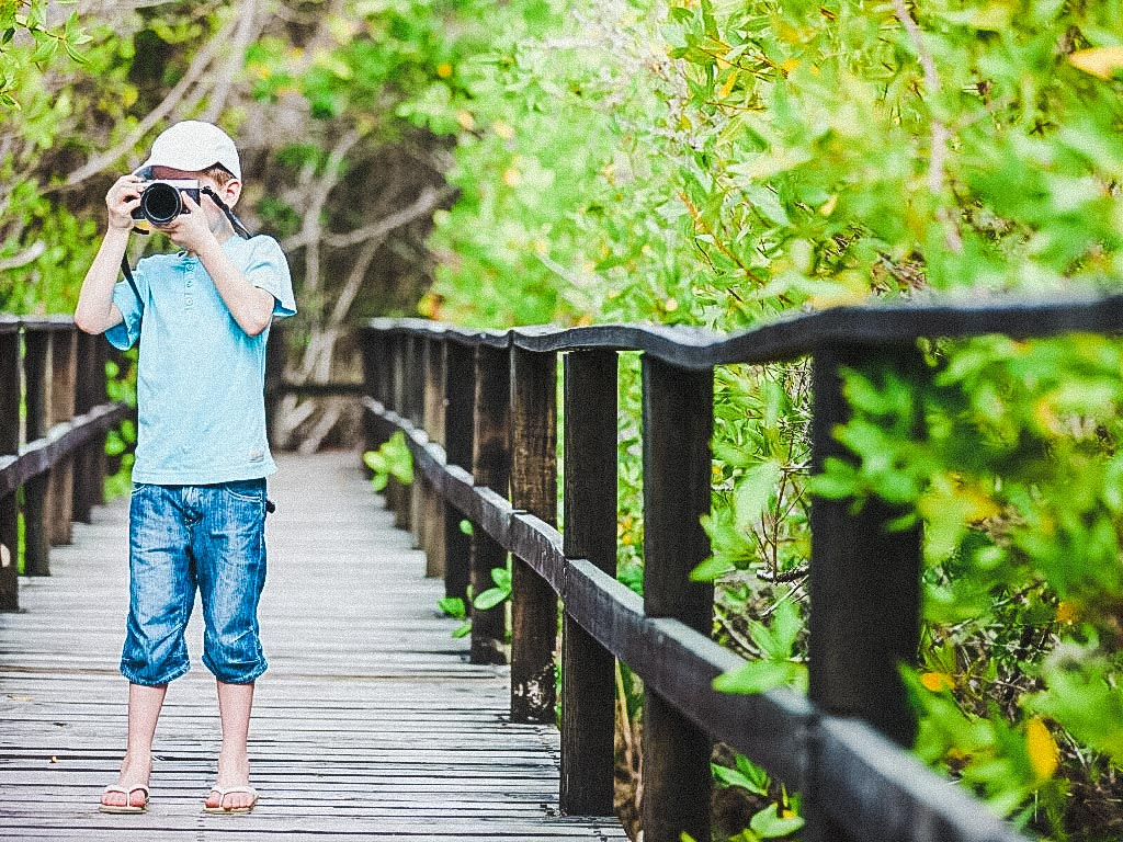Child taking photos on a camera