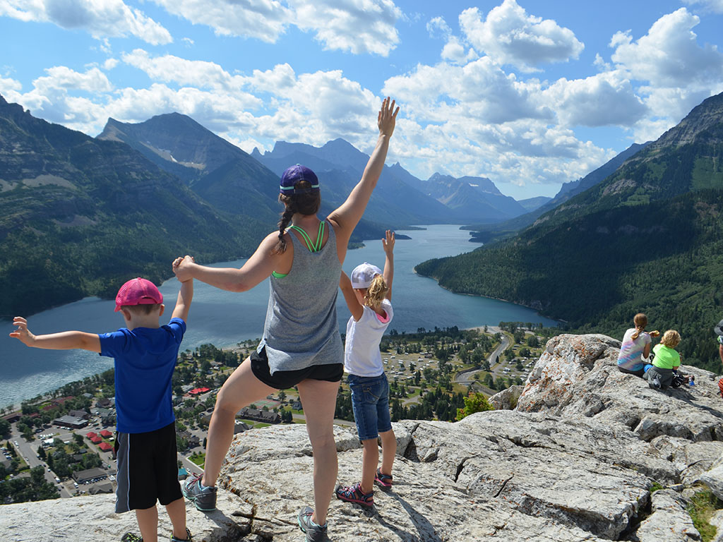 Jami Savage and kids on the top of a mountain