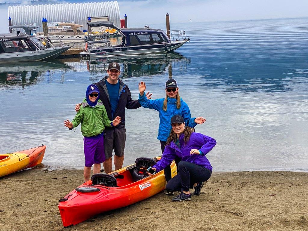 Family posing on beach for Harrison Lake Kayaking