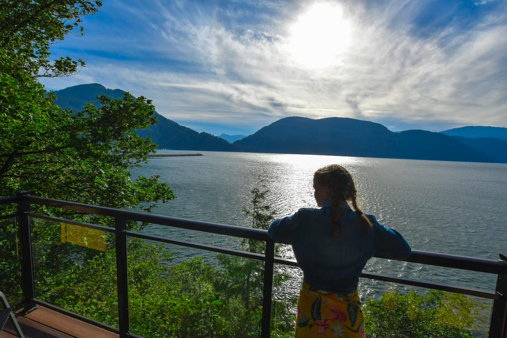 Girl looking out from the balcony at The Lodge At Harrison Lake