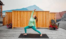 woman doing yoga in banff