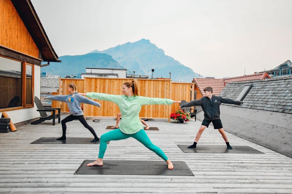 family practicing yoga at Banff Family Sunrise Yoga