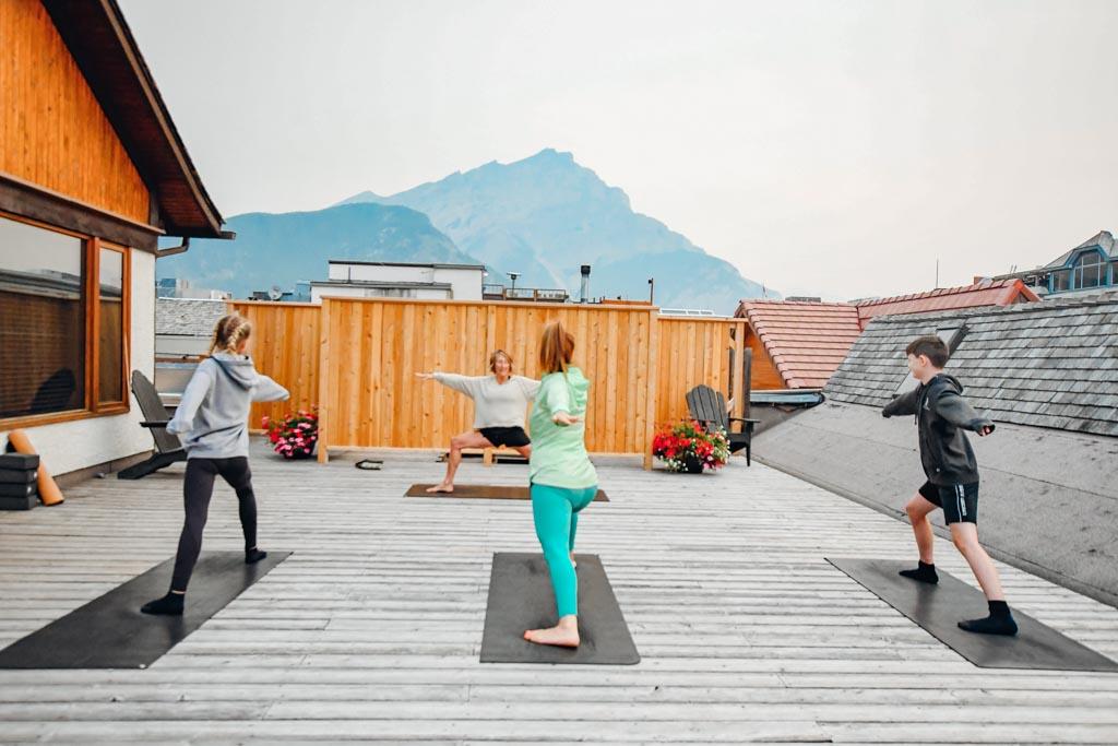 woman and two kids doing yoga at Banff Family Sunrise Yoga