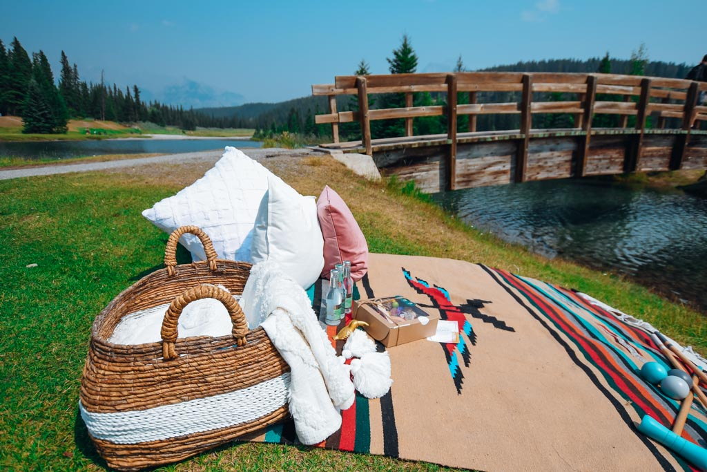 close up view of picnic blanket with a mountain of pillows