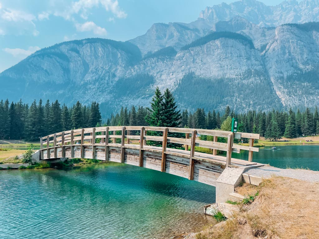 wooden foot bridge over a wide river