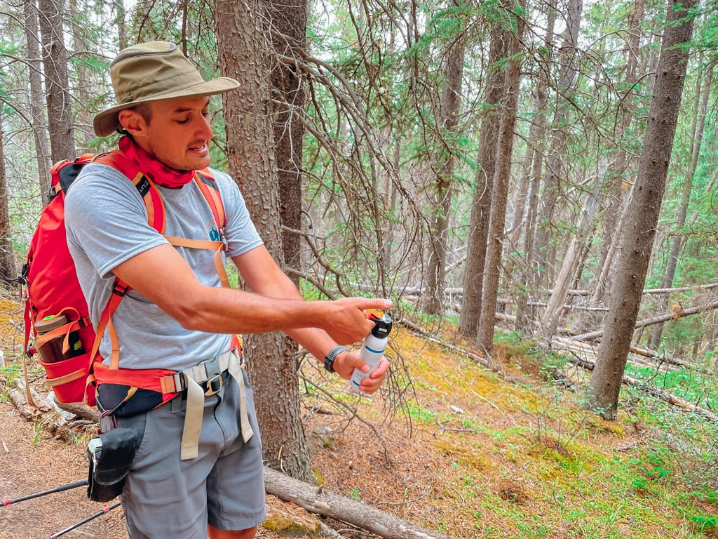 hiking guide demonstrating how to use bear spray