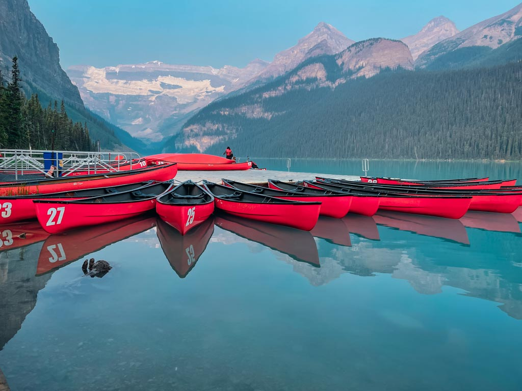 canoes lined up on lake louise