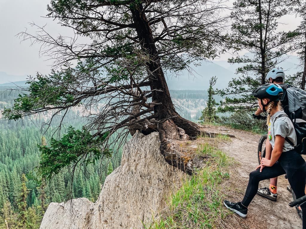 girl overlooking a cliff at Family Mountain Bike Tour in Banff