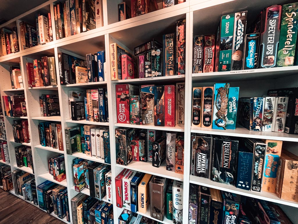 wall of board games at the Hexagon Board Game Cafe in calgary