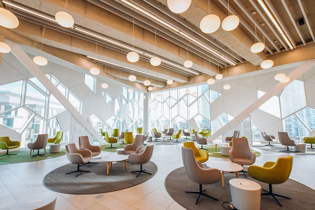 large seating and gathering area inside the calgary central library