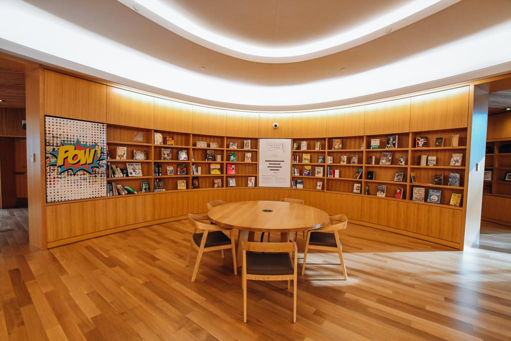 corner study space with a round table and bookshelves behind