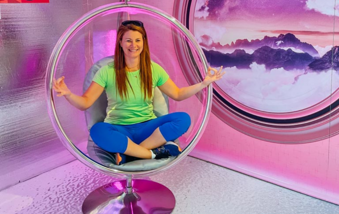 woman sitting in dome seat at science centre