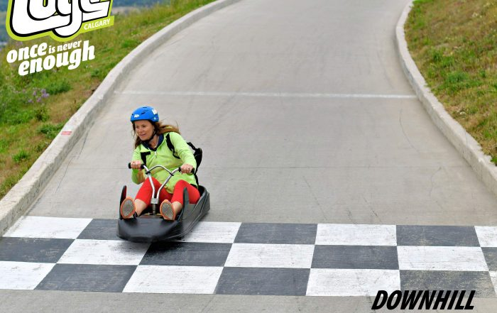 woman at finish line on a downhill kart at WinSport Calgary