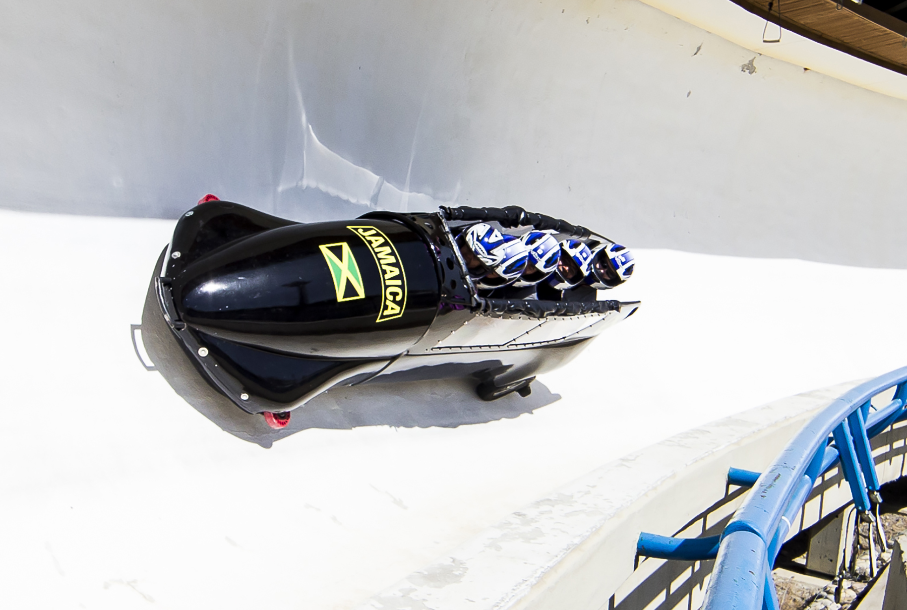 people in a bobsleigh going down the track at WinSport Calgary