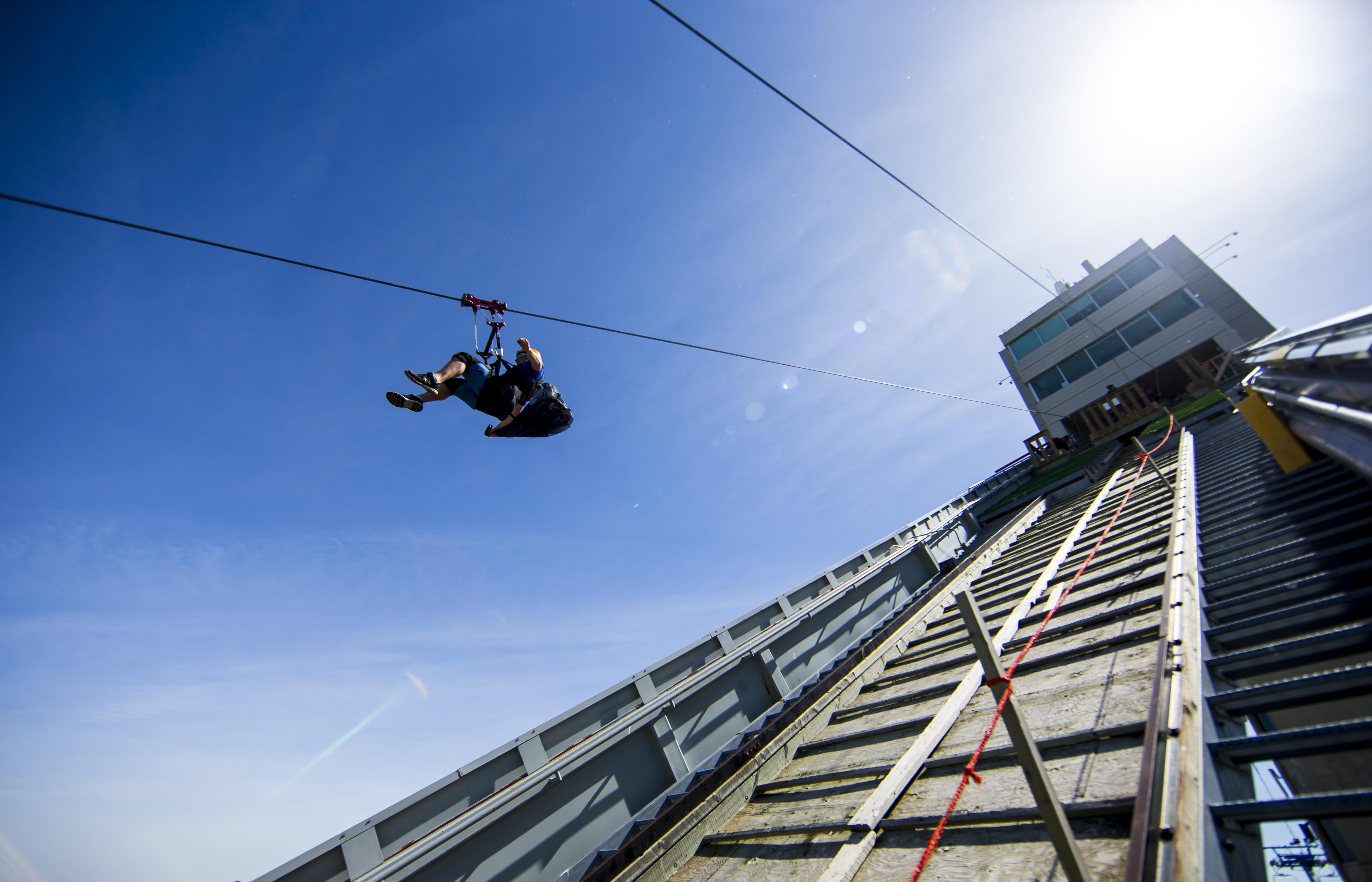 person on zipline at WinSport Calgary